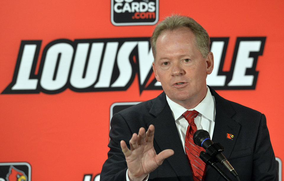Photo - New Louisville NCAA college head football coach Bobby Petrino address reporters following the announcement of his hiring Thursday, Jan. 9, 2014 at Papa John's Cardinal Stadium in Louisville, Ky. (AP Photo/Timothy D. Easley)