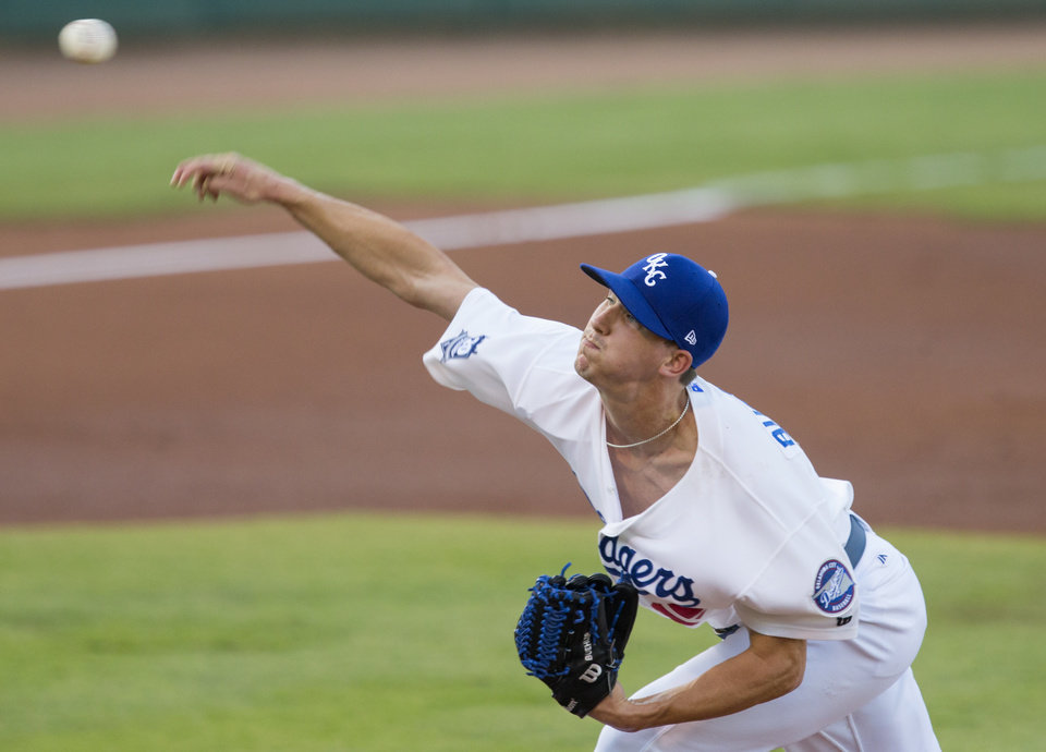 Photo - OKC pitcher Walker Buehler throws a pitch during his Triple-A debut Thursday. Photo by Bryan Terry, The Oklahoman