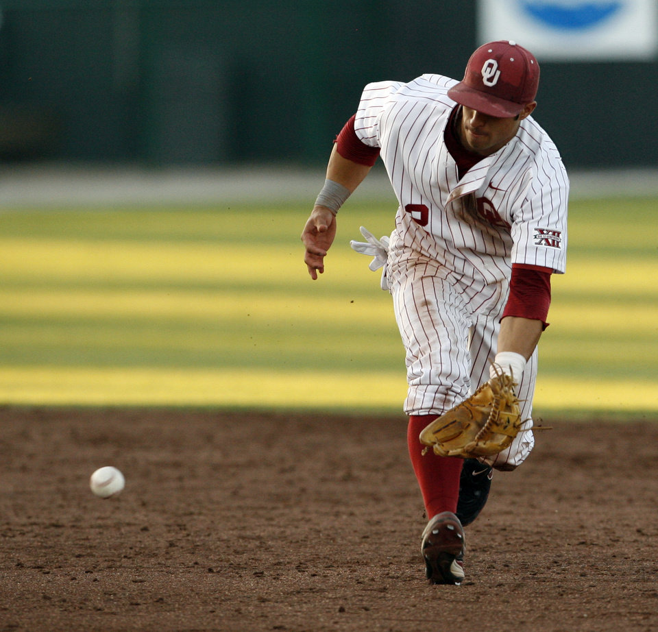 Photo - Bryant Hernandez makes the play as the University of Oklahoma plays Wichita State at L. Dale Mitchell Park in the NCAA Regional baseball tournament in Norman, Okla. on Friday, May 29, 2009. 