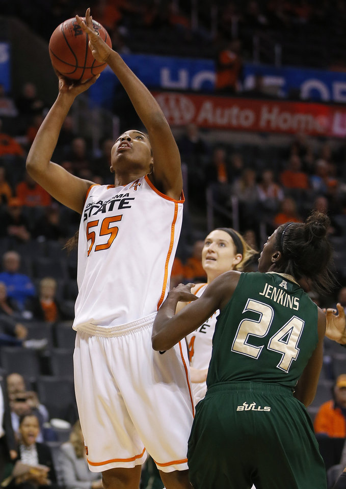 Oklahoma State's LaShawn Jones (55) shoots the ball beside South Florida's Alisia Jenkins (24) during the All-College Classic women's basketball game between Oklahoma State University and South Florida at Chesapeake Energy Arena in Oklahoma City, Okla., Saturday, Dec. 14, 2013. Photo by Bryan Terry, The Oklahoman