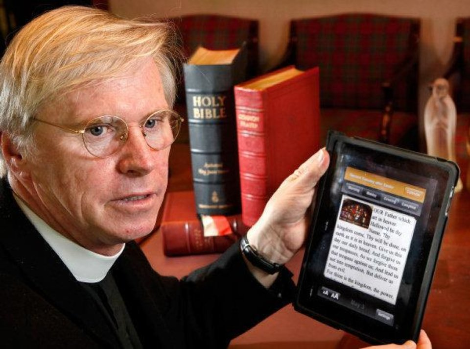 Photo - The Rev. Patrick Bright, rector of All Souls Episcopal Church, helped  create an iPhone app of the Book of Common Prayer, most commonly used by Anglicans, known as Episcopalians in the United States.  JIM BECKEL - THE OKLAHOMAN