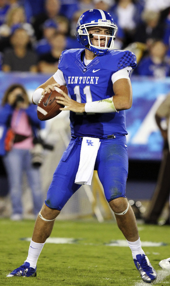 Photo -   Kentucky's Maxwell Smith looks for a receiver during the third quarter of an NCAA college football game against Kent State in Lexington, Ky., Saturday, Sept. 8, 2012. Kentucky won 47-14. (AP Photo/James Crisp)