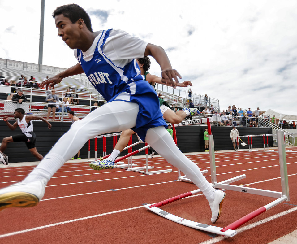 Durant's Gabriel Louis hits a hurdle while running in the 5A boys 110m hurdles during the class 5A and 6A track state championships at Yukon High School on on Friday, May 10, 2013, in Yukon, Okla.Photo by Chris Landsberger, The Oklahoman