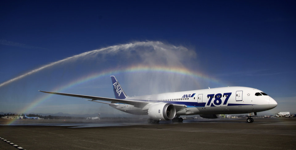 A Boeing 787 operated by All Nippon Airways taxis under a rainbow created by fire trucks at Seattle-Tacoma International Airport, Monday, Oct. 1, 2012, in Seattle, during an official welcome ceremony after it landed on the first day of service for the aircraft on ANA's Seattle-Tokyo route. (AP Photo/Ted S. Warren)
