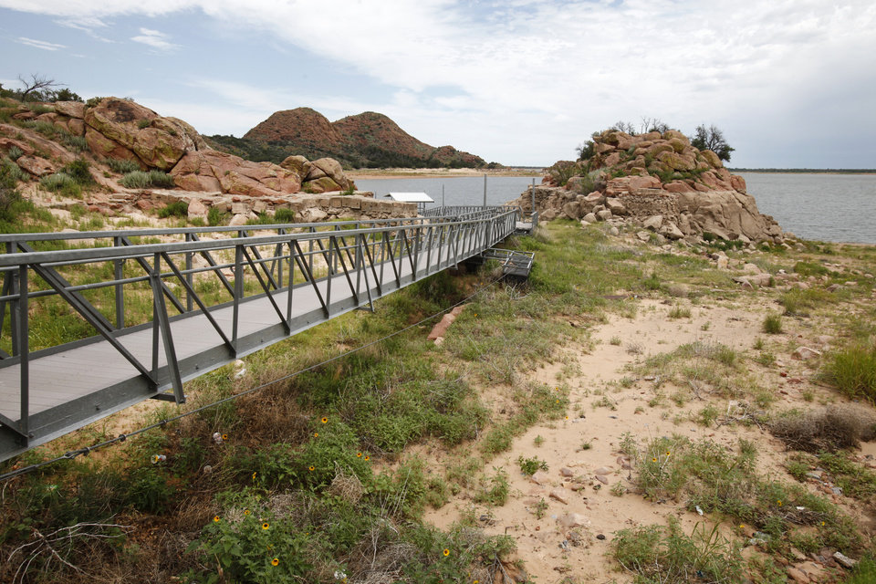 Photo - Drought. Walkway to what should be a floating fishing dock at Lake Altus-Lugert near Altus,  June 30, 2014.   Photo by David McDaniel, The Oklahoman