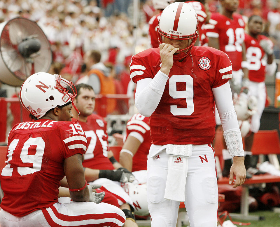Photo - Sam Keller of Nebraska walks by the bench in the final minutes of their loss to OSU in the college football game between Oklahoma State University (OSU) and the University of Nebraska at Memorial Stadium in Lincoln, Neb., on Saturday, Oct. 13, 2007. By Bryan Terry, The Oklahoman