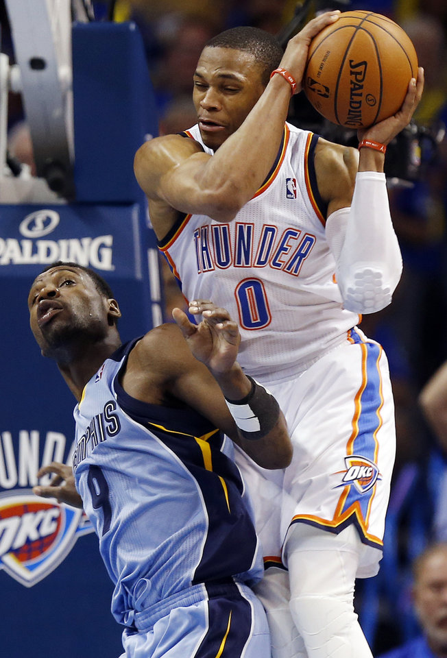 Photo - Oklahoma City's Russell Westbrook (0) is fouled by Memphis' Tony Allen (9) during Game 7 in the first round of the NBA playoffs between the Oklahoma City Thunder and the Memphis Grizzlies at Chesapeake Energy Arena in Oklahoma City, Saturday, May 3, 2014. Photo by Nate Billings, The Oklahoman
