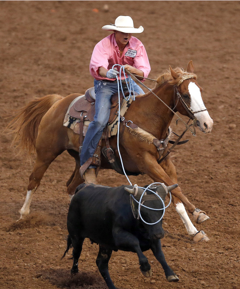 Whitson Montana competes in team roping during the International Finals Youth Rodeo in Shawnee, Okla., Sunday, July 8, 2012. Photo by Sarah Phipps, The Oklahoman