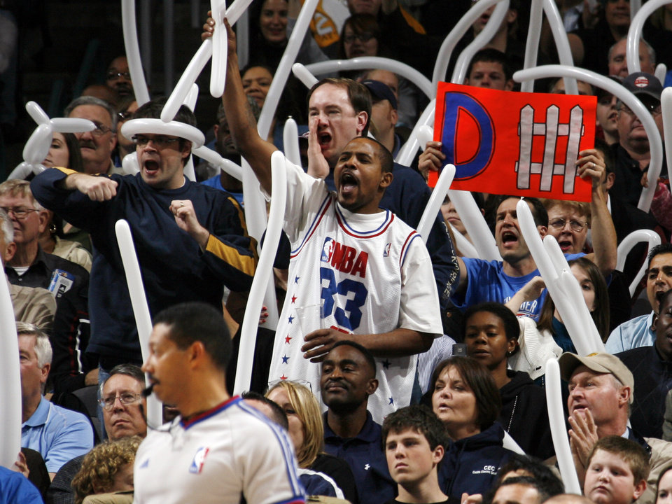 Photo - Thunder fans cheer in the second half of the NBA basketball game between the Oklahoma City Thunder and the Houston Rockets at the Ford Center in Oklahoma City, Monday, Nov. 17, 2008. Houston won, 100-89. BY NATE BILLINGS, THE OKLAHOMAN ORG XMIT: KOD