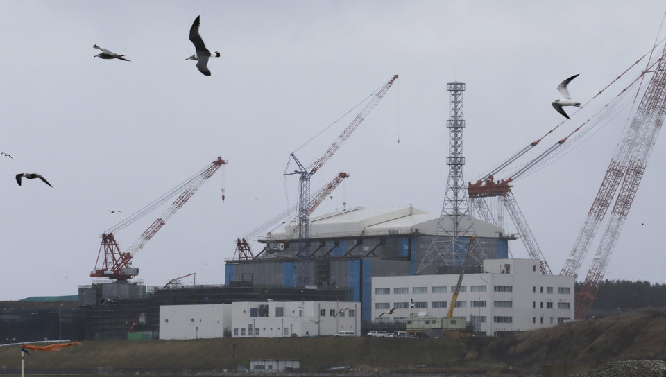 Photo - In this Nov. 9, 2012 photo, seagulls fly near the Oma nuclear power plant surrounded by cranes in Oma in Aomori, northern Japan. In nearby Oma, construction is set to resume on an advanced reactor that is not a fast-breeder but can use more plutonium than conventional reactors. Its construction, begun in 2008 for planned operation in 2014, has been suspended since the March 2011 Fukushima nuclear meltdowns, and could face further delays as Japan's new nuclear watchdog prepares new safety guidelines. (AP Photo/Koji Sasahara)