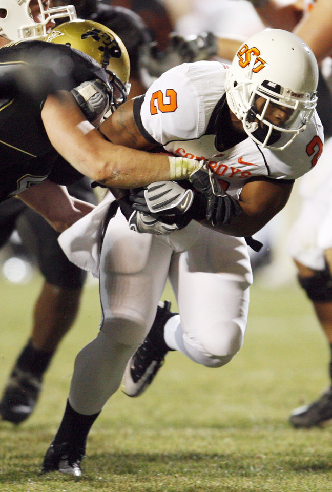 Photo - OSU's Beau Johnson (2) runs the ball in the third quarter during the college football game between Oklahoma State University and University of Colorado at Folsom Field in Boulder, Colo., Saturday, Nov. 15, 2008. OSU won, 30-17. BY NATE BILLINGS, THE OKLAHOMAN