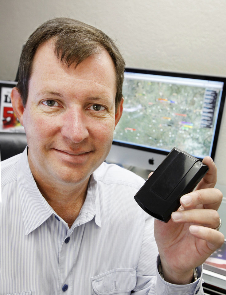 Jerry Hunter, co-founder and CEO of U.S. Fleet Tracking, is shown in this 2010 photo displaying one of his company\'s tracking units. PAUL B. SOUTHERLAND - Oklahoma Archive Photo