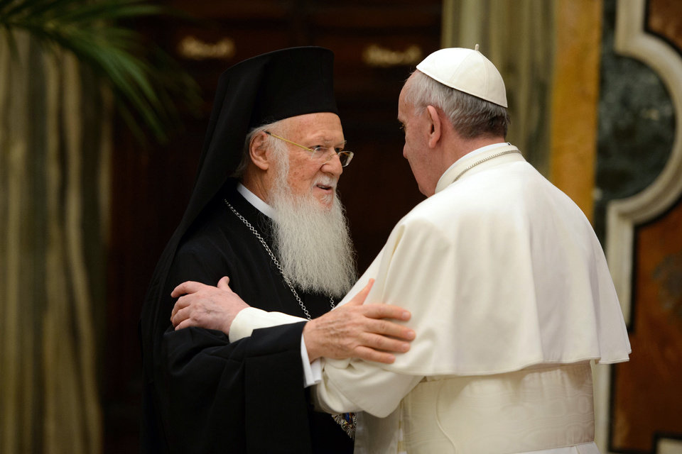 "Photo - FILE- In this March 20, 2013, file photo provided by the Vatican paper L' Osservatore Romano, Pope Francis, right, meets Bartholomew I, the first ecumenical patriarch to attend the installation of a Pope since the Catholic and Orthodox church split nearly 1,000 years ago, at the Vatican. Pope Francis insists his weekend pilgrimage to the Middle East is a ""strictly religious"" commemoration of a key turning point in Catholic-Orthodox relations. But the three-day visit is the most delicate mission of his papacy and will test his diplomatic chops as he negotiates Israeli-Palestinian tensions and fallout from Syria's civil war. (AP Photo/Osservatore Romano, File)"