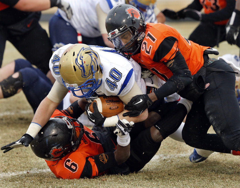 Photo - Douglas' Johnny Jones (6) and Barry Knight (21) combine to bring downs Oologah's Jimmy McKinney in high school football playoff action on Saturday, Nov. 23, 2013, in Oklahoma City, Okla. Photo by Steve Sisney, The Oklahoman