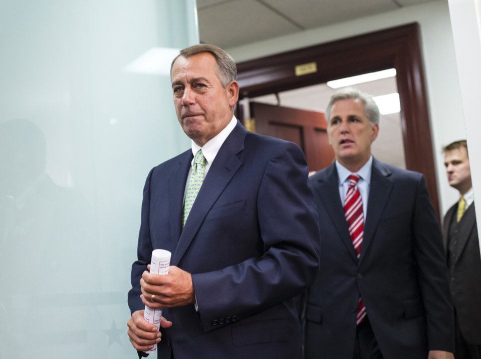 Speaker of the House John Boehner, R-Ohio, and House Republican leaders emerge from a closed-door strategy session at the Capitol, Wednesday, Sept. 18, 2013. House GOP leaders are looking to reverse course and agree to tea party demands to try to use a vote this week on a must-pass temporary government funding bill to block implementation of President Barack Obama\'s health care law. Boehner is followed by House Majority Whip Kevin McCarthy, R-Calif. (AP Photo/J. Scott Applewhite)