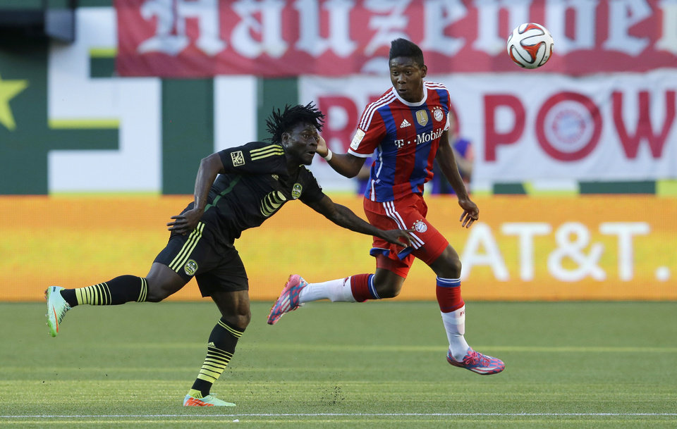 Photo - MLS All-Stars' Obafemi Martins, left, of the Seattle Sounders, and Bayern Munich's David Alaba, right, vie for a header in the first half of the MLS All-Star soccer game, Wednesday, Aug. 6, 2014, in Portland, Ore. (AP Photo/Ted S. Warren)
