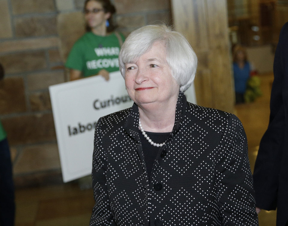Photo - Federal Reserve Chair Janet Yellen arrives for a dinner during the Jackson Hole Economic Policy Symposium at the Jackson Lake Lodge in Grand Teton National Park near Jackson, Wyo. Thursday, Aug. 21, 2014. (AP Photo/John Locher)