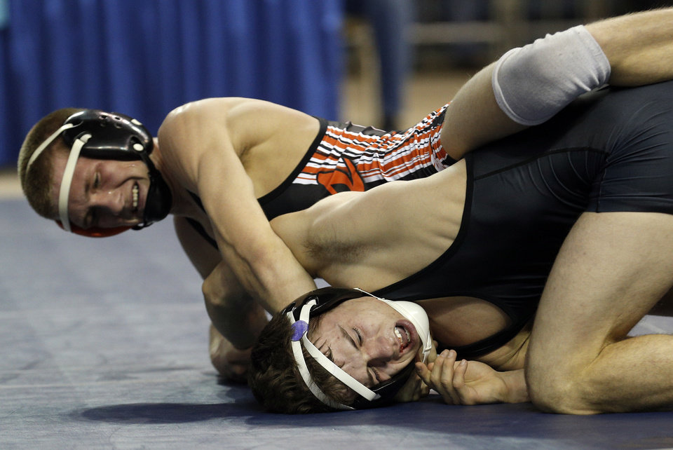 Photo - Tonkawa's Brandon Hurst, top, wrestles Jay's Derick Shrum in the class 3A 132-pound match  during the Oklahoma State wrestling championships at the State Fair Arena, Saturday, March 1. 2014. Photo by Sarah Phipps, The Oklahoman