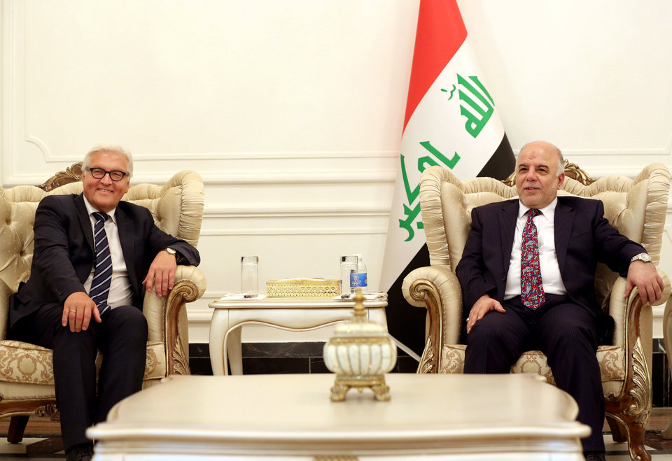 Photo - Iraqi Prime Minister Haider al-Abadi, right, speaks during a meeting with German's Foreign Minister Frank-Walter, left, in Baghdad, Iraq, Saturday, Aug 16, 2014. (AP Photo/Hadi Mizban, Pool)