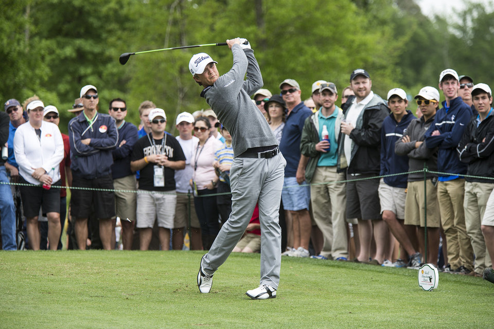 Photo - Matt Jones tees off on the 11th hole during the third round of the Houston Open golf tournament on Saturday, April 5, 2014, in Humble, Texas. (AP Photo/The Courier, Andrew Buckley)