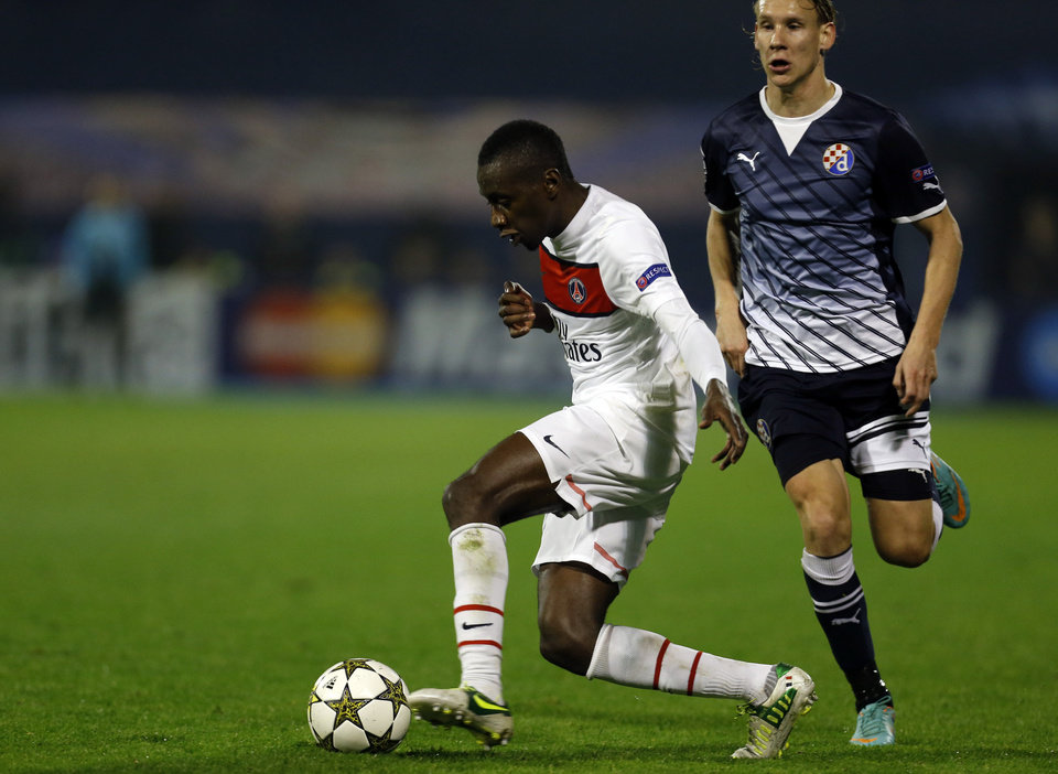 Photo -   PSG's Blaise Matuidi, left, is challenged by Dinamo's Domagoj Vida during the Champions League group A soccer match between Dinamo Zagreb and PSG, in Zagreb, Croatia, Wednesday, Oct. 24, 2012. (AP Photo/Darko Bandic)