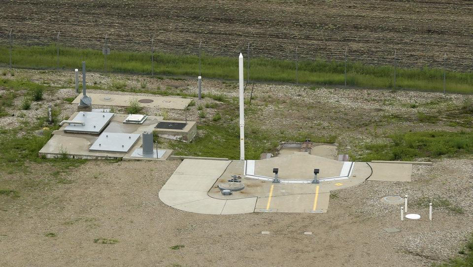 """Photo - This photo taken June 24, 2014 shows an ICBM launch site located among fields in the countryside outside Minot, N.D. on the Minot Air Force Base. The nuclear missiles hidden in plain view across the prairies of northwest North Dakota reveal one reason why trouble keeps finding the nuclear Air Force. The """"Big Stick,"""" as some call the 60-foot-tall Minuteman 3 missile, is just plain old. (AP Photo/Charlie Riedel)"""