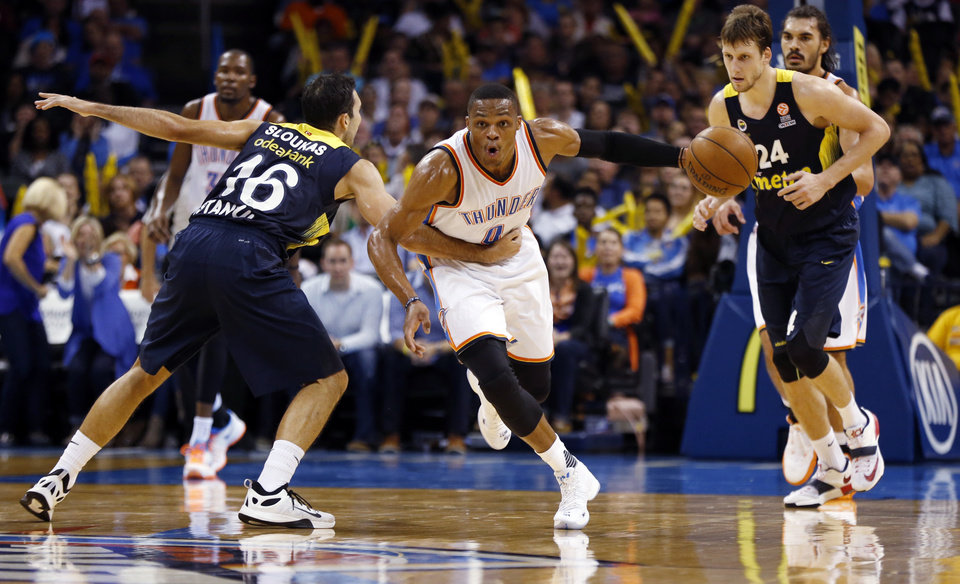 Photo - Oklahoma City's Russell Westbrook (0) steals the ball from FenerbahceÕs Kostas Sloukas during the second half of an NBA basketball pre-season game between the Oklahoma City Thunder and Fenerbahce Ulker at Chesapeake Energy Arena on Oct. 9, 2015 in Oklahoma City, Okla. The Thunder won 111-81.  Photo by Steve Sisney, The Oklahoman