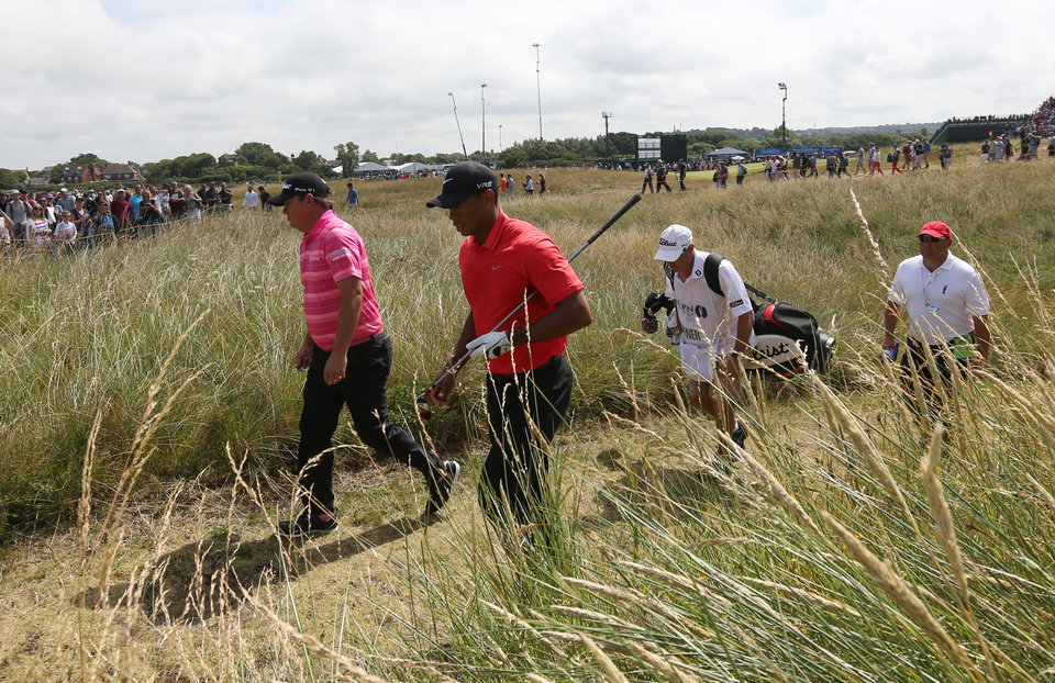 Photo - Jason Dufner of the US, left, and Tiger Woods of the US walk off the 17th tee box during the final round of the British Open Golf championship at the Royal Liverpool golf club, Hoylake, England, Sunday July 20, 2014. (AP Photo/Jon Super)