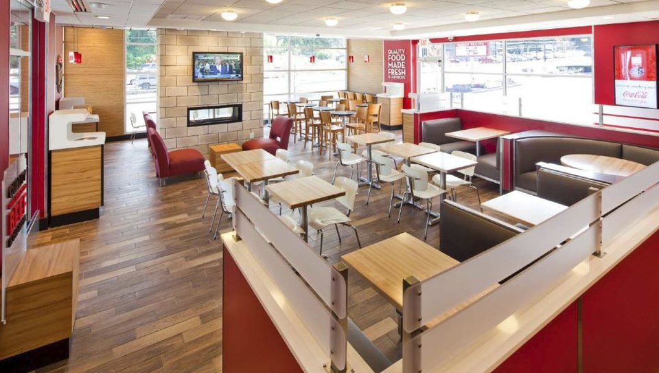 This photo provided by Wendy's Co. on March 1, 2012, photo, shows the interior of a remodeled restaurant. Wendy's push to remake itself as a higher-end hamburger chain is starting to pay off, with a key sales figure rising for the sixth straight quarter. The company, based in Dublin, Ohio, is trying to pull away from the image of the typical fast-food chain and cast itself as a purveyor of higher-quality burgers and sides. The move reflects the growing popularity of chains such as Chipotle and Panera, which offer better quality food for slightly higher prices. (AP Photo/Wendy's Co.)