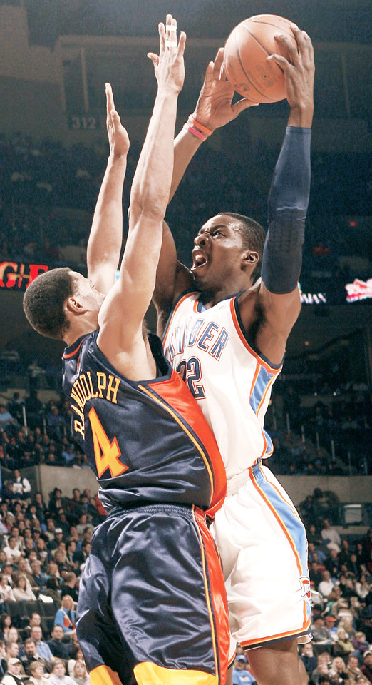 Photo - Oklahoma City's Jeff Green, right, puts up a shot over Golden State's Anthony Randolph during action on Monday at the Ford Center. Green had 21 points and 13 rebounds in the win. Photo by Chris Landsberger, The Oklahoman