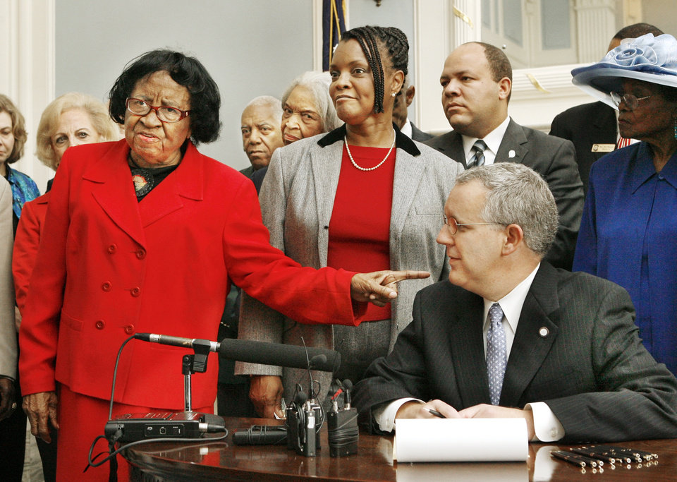 Photo - Civil rights advocate Clara Luper, left, makes some stern comments about funding and the lack of being asked to participate in the development of the African American Centennial Plaza while pointing a finger at Gov, Brad Henry as Oklahoma state Sen. Connie Johnson, center, D-Oklahoma City, looks on before the Governor signed a ceremonial copy of Senate Bill 1919 at the state Capitol in Oklahoma City Thursday, Oct. 26, 2006. SB 1919 clears the way for developing the African American Centennial Plaza on the grounds of the state Capitol. A committee will oversee the design, funding and construction of the plaza, which will be built off Lincoln Boulevard near the Capitol. BY PAUL B. SOUTHERLAND, THE OKLAHOMAN ORG XMIT: KOD