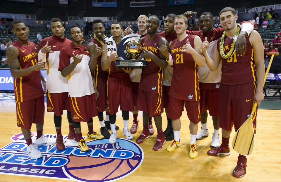 Photo - The Iowa State basketball team shows off the Diamond Head Classic championship trophy after defeating Boise State in an NCAA college basketball game Wednesday, Dec. 25, 2013, in Honolulu. Iowa State won 70-66. (AP Photo/Eugene Tanner)