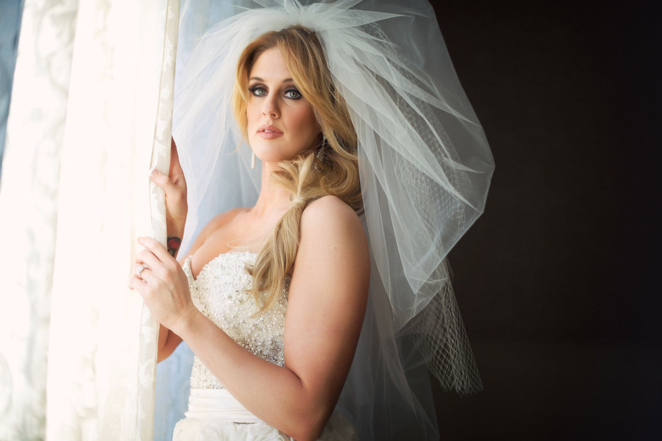 Malorie Gulikers poses during her bridal photo shoot. Photo by Traina Photography.