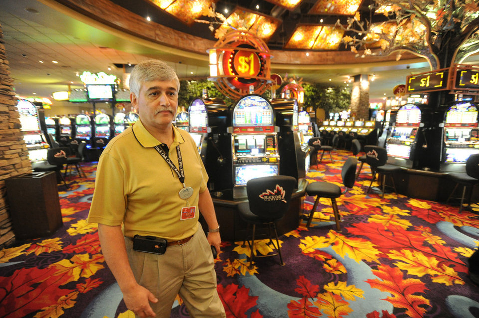 Black Oak Casino general manager Ron Patel walks the nearly empty gambling room floor, which is open to customers, but inaccessible due to road closures into and around Tuolumne City due to the Rim Fire which continues to burn in the Stanislaus National Forest Saturday Aug. 24, 2013.  Thousands of would be gamblers would normally walk through the doors of Black Oak Casino on a regular Saturday, but Patel has only counted 30. (AP Photo/The Modesto Bee, Elias Funez)