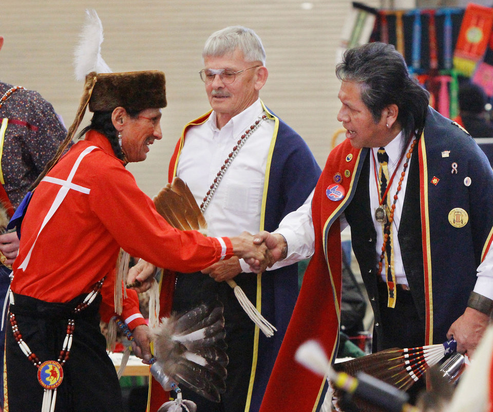 Steve Kaudlekaule shakes hands of fellow dancers during one of the gourd dances.  He is a member of the Comanche Nation and drove from  Ponca City to attend the pow-wow.  At least 500 people representing several dozen Native American Nations within the state attended  a New Year's pow-wow in the Centennial Building at State Fair Park Saturday , January 7, 2012,   The celebration started around shortly after noon and continued into the night.   Several hundred took part in the various dancers and the dancers wore tribal regalia.  Photo by Jim Beckel, The Oklahoman