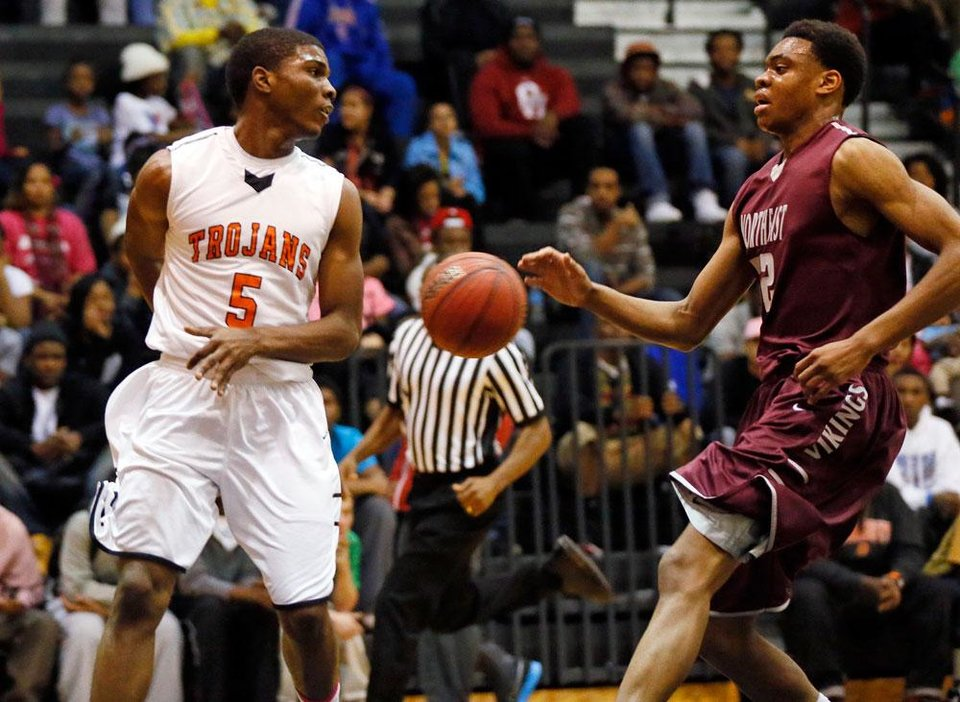 Photo -  Stephen Clark (5) of Douglass passes behind his back around Deshawn Watson (32) of Northeast during a boys high school basketball game between Douglass and Northeast at Douglass High School in Oklahoma City, Friday, Feb. 8, 2013. Photo by Nate Billings, The Oklahoman