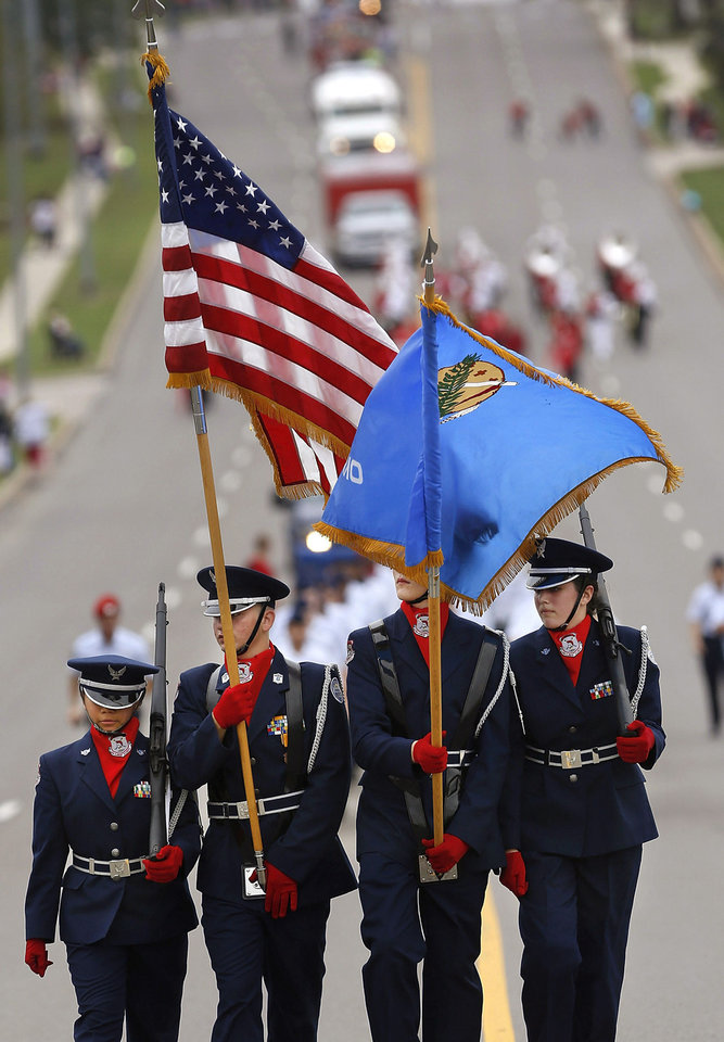Carl Albert's Junior ROTC Color Guard marches at the front of the parade. photo by Jim Beckel,  THE OKLAHOMAN