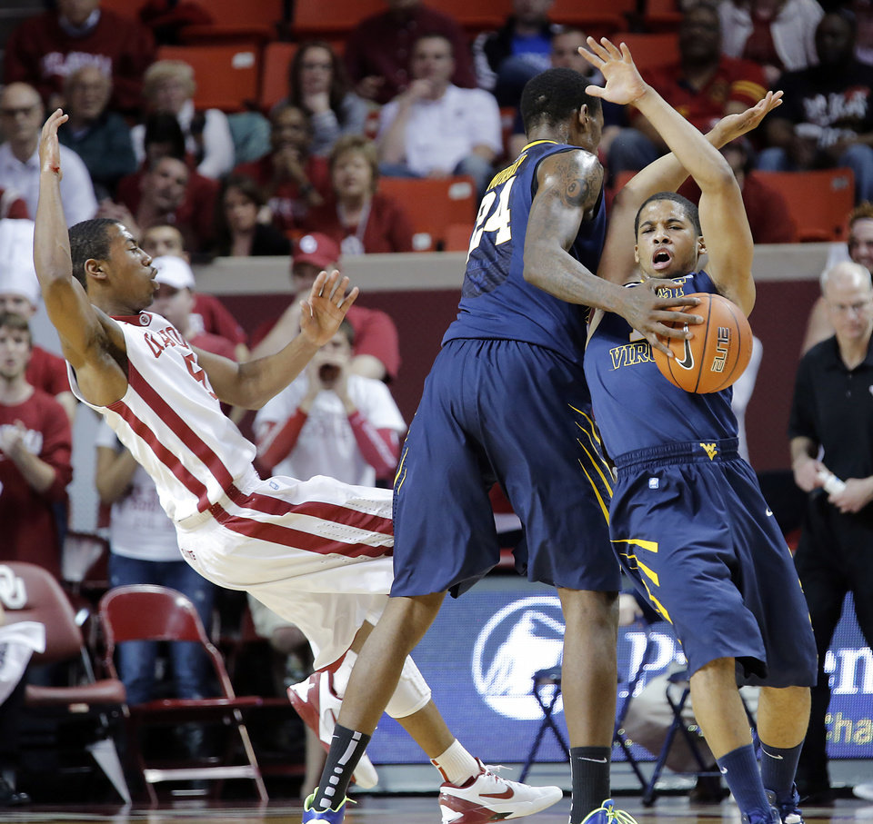 Oklahoma's Je'lon Hornbeak (5) and West Virginia 's Gary Browne (14) collide as West Virginia 's Aaric Murray (24) tries to hand the ball off during the second half of the college basketball game between the University of Oklahoma Sooners (OU) and the West Virginia University Mountaineers (WVU) at the Lloyd Noble Center on Wednesday, March 6, 2013, in Norman, Okla. Photo by Chris Landsberger, The Oklahoman