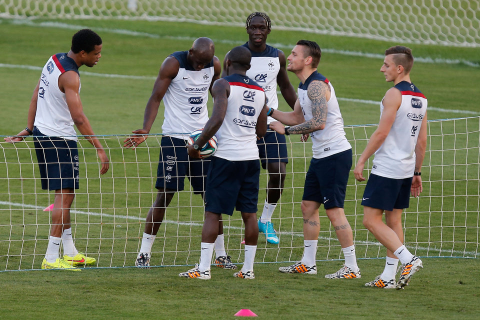 Photo - Players of the French national soccer team, from left, Loic Remy, Eliaquim Mangala, Rio Mavuba, Bakary Sagna, Mathieu Debuchy and Lucas Digne play tennis-ball during a training session at the Santa Cruz stadium in Ribeirao Preto, Brazil, Sunday, June 22, 2014. Having captured people's attention at the soccer World Cup with some scintillating attacking football, France's players are now in unknown territory after raising expectations back home, having routed Switzerland and Honduras. (AP Photo/David Vincent)