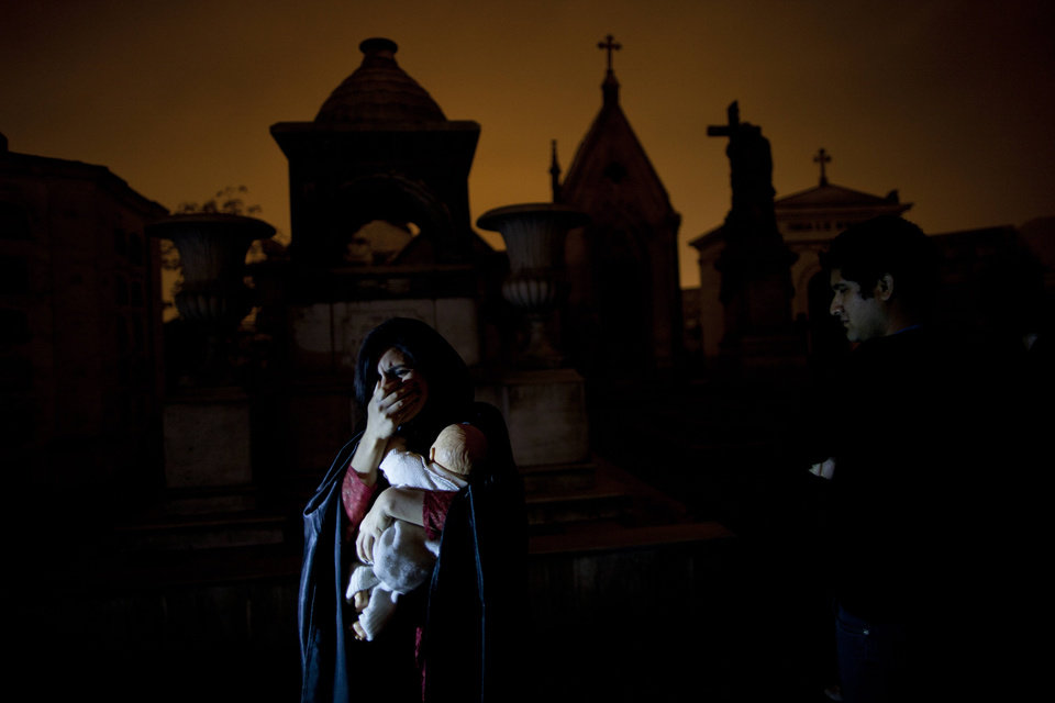 Photo - In this Nov.10, 2012 photo, a woman dramatizes a historic event during a nighttime guided tour through the Presbitero Matias Maestro cemetery in Lima, Peru. When Presbitero Matias Maestro cemetery in Lima received its first body in 1808, the best plots went to the elite, unless the noble had been dishonored or disgraced. (AP Photo/Rodrigo Abd)