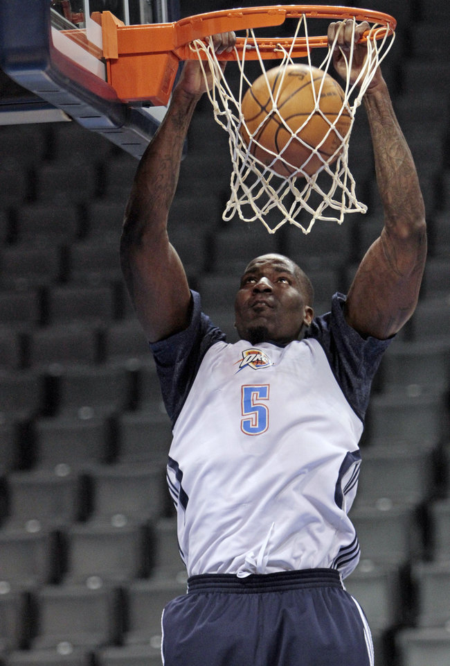 Photo - Oklahoma City Thunder's Kendrick Perkins dunks during practice in preparation for game two of the NBA basketball finals at the Chesapeake Arena on Wednesday, June 13, 2012 in Oklahoma City, Okla.  Photo by Steve Sisney, The Oklahoman