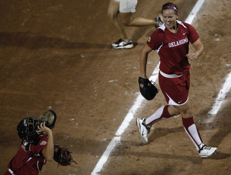 Keilani Ricketts (10) celebrates with Jessica Shults (18) during Game 3 of the Women's College World Series softball championship between OU and Alabama at ASA Hall of Fame Stadium in Oklahoma City, Wednesday, June 6, 2012.  Photo by Garett Fisbeck, The Oklahoman