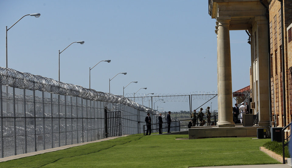 Photo - President Barack Obama's group enters the El Reno Federal Correctional Institution in El Reno, Okla., Thursday, July 16, 2015. Photo by Sarah Phipps, The Oklahoman