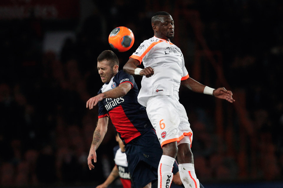 Photo - Paris Saint Germain's Jeremy Menez, left, challenges for the ball with Valencienne's Hamed Doumbia, during their French League one soccer match, at the Parc des Princes stadium, in Paris, Friday, Feb. 14, 2014. (AP Photo/Thibault Camus)