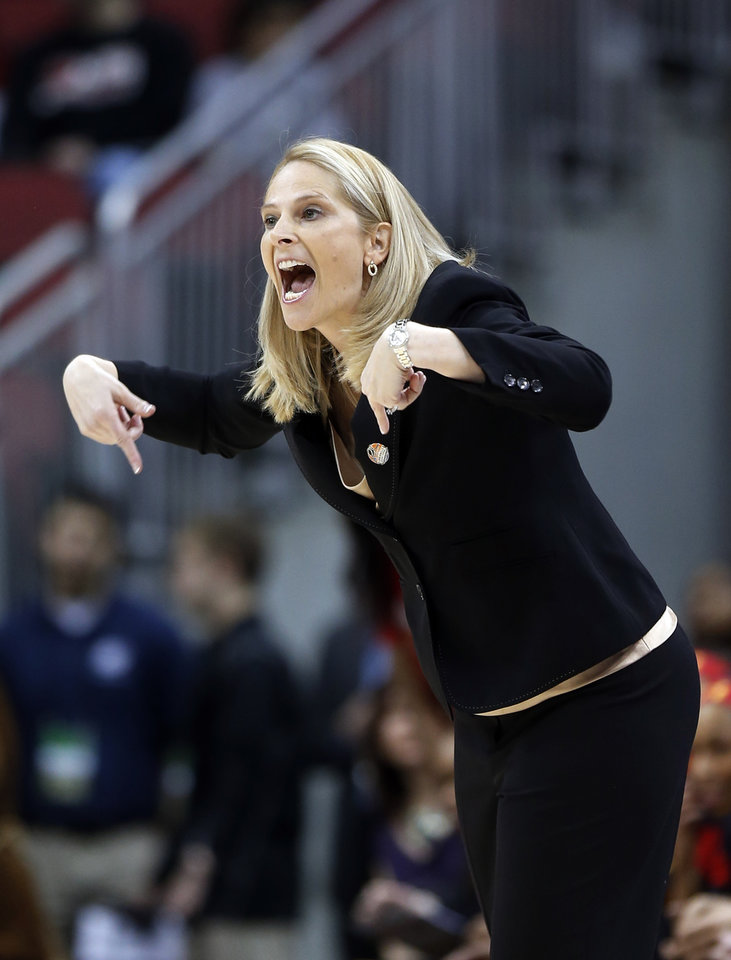 Photo - Maryland head coach Brenda Frese direst her players from the sideline during the first half of a regional semifinal game against the Tennessee at the NCAA women's college basketball tournament, Sunday, March 30, 2014, in Louisville, Ky. (AP Photo/John Bazemore)