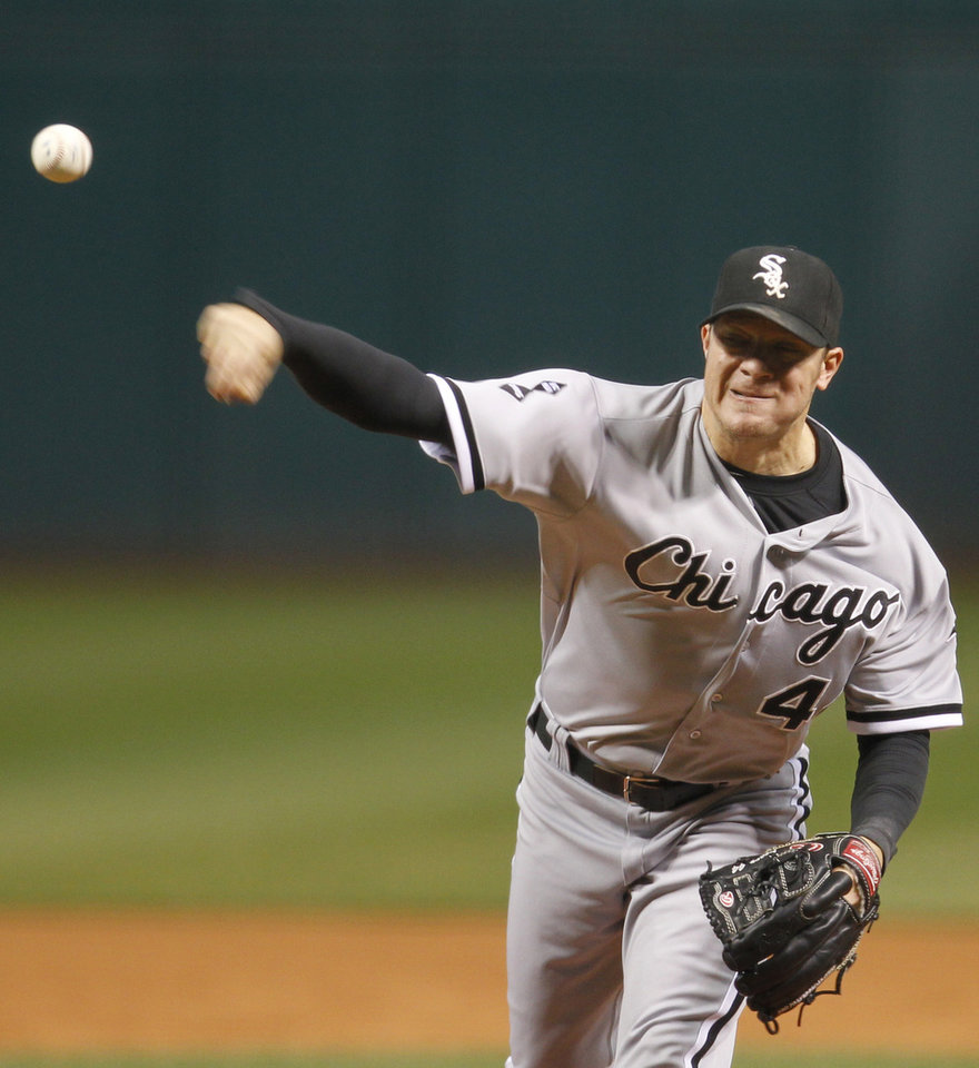 Chicago White Sox starting pitcher Jake Peavy throws during the first inning of a baseball game against the Cleveland Indians, Tuesday, Oct. 2, 2012, in Cleveland. (AP Photo/Tony Dejak)