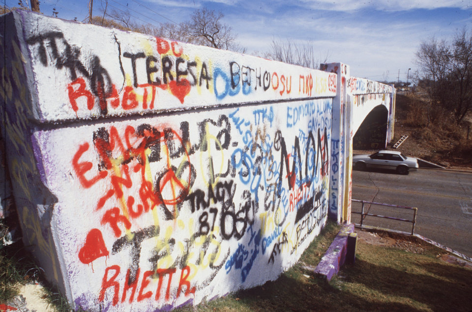 Photo - Graffiti bridge at NW 50th and  Western Ave. BY JIM ARGO , THE OKLAHOMAN.