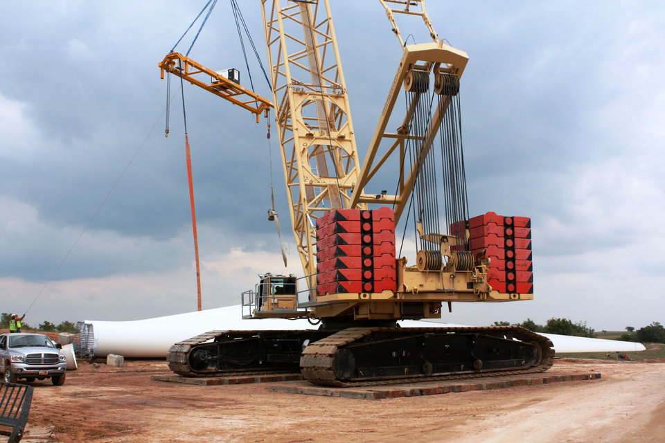 Photo - These photos provided by OG&E show the construction of the OU Spirit wind farm near Woodward on Sept. 17. ORG XMIT: KOD