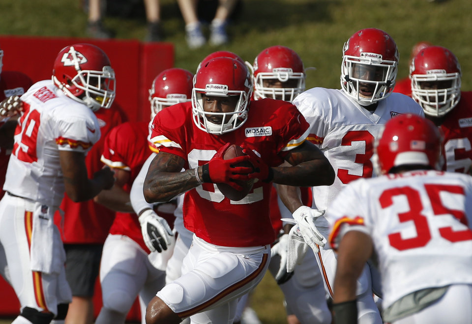 Kansas City Chiefs wide receiver Dwayne Bowe (82) runs after a catch during NFL football training camp in St. Joseph, Mo., Thursday, Aug. 1, 2013. (AP Photo/Orlin Wagner)