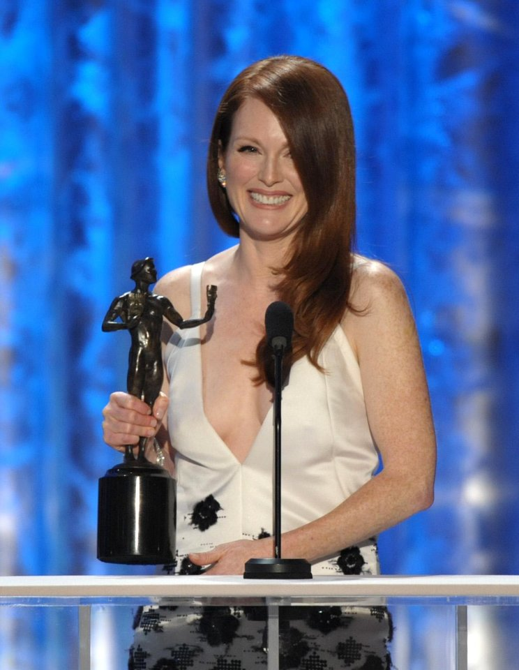 "Photo - Julianne Moore accepts the award for outstanding female actor in a TV movie or miniseries for ""Game Change"" at the 19th Annual Screen Actors Guild Awards at the Shrine Auditorium in Los Angeles on Sunday, Jan. 27, 2013. (Photo by John Shearer/Invision/AP)"